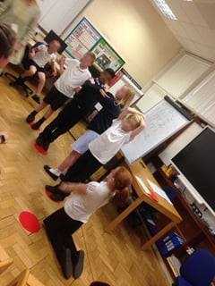 Children trying out a rhythm pattern