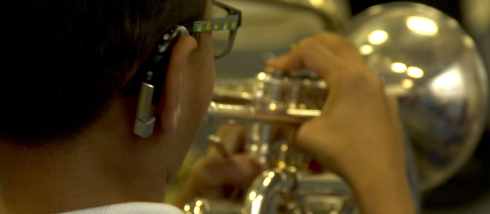 A hearing impaired boy in Bradford is playing the trumpet for the first time