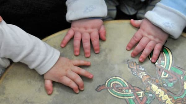 Babies hands on an Irish drum