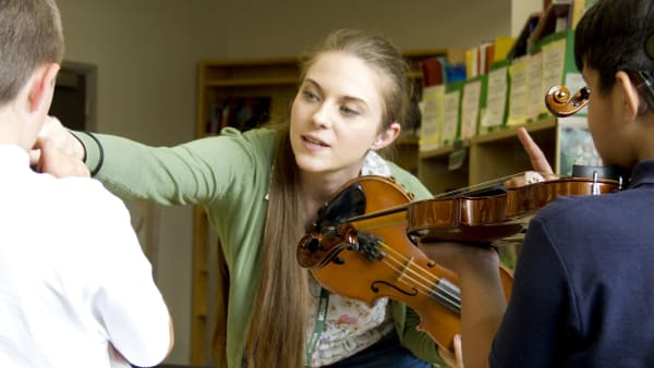 Eloise Garland teaches two D/deaf children to play the violin