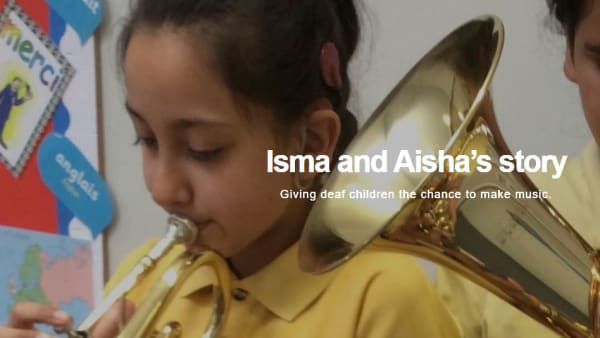 Primary school children Isma and Aisha both playing the trumpet